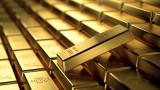 Златото поевтинява успоредно с укрепването на долара