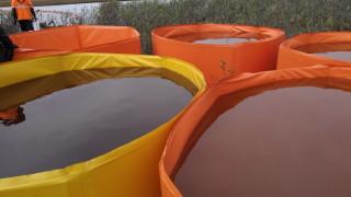 Поне още седмица чистят петролния разлив край Норилск