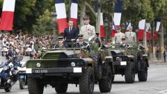 Пищен парад на Деня на Бастилията в Париж показа европейското военно сътрудничество