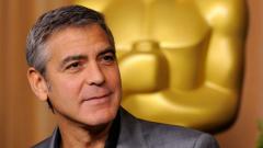Джордж Клуни храни бездомници