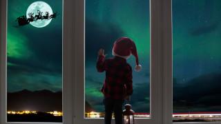 Дядо Коледа пише писмо на децата