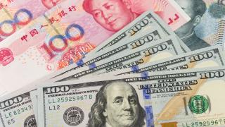 Китай продължава да девалвира юана