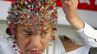 Китаец с 2008 пиърсинга в чест на Олимпиадата