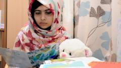 Малала с титаниева платина в черепа й