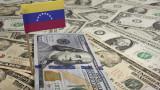 Една от най-богатите на петрол страни се отказва от долара за сметка на еврото и юана