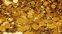 Фючърсите на златото скочиха до невиждана в историята стойност
