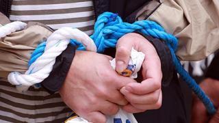 Млади учени с вързани ръце на протест в София