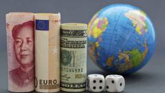 Доларът се обезценява спрямо паунда, еврото и юана