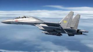 Китай изпрати ВВС и ВМС срещу американски кораб нарушител в Южнокитайско море