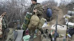 Луганските сепаратисти започнаха да изтеглят артилерията от фронта