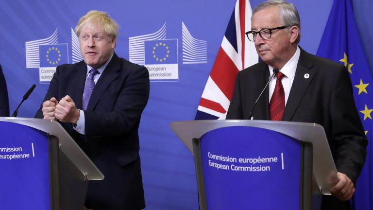Председателят на Европейската комисия Жан-Клод Юнкер и премиерът на Великобритания