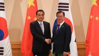 КНДР трябва да получи помощ, ако остави ядрените оръжия, съгласни Пекин и Сеул