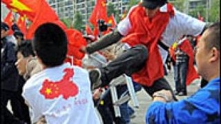 Сблъсъци съпроводиха Олимпийския огън през Сеул