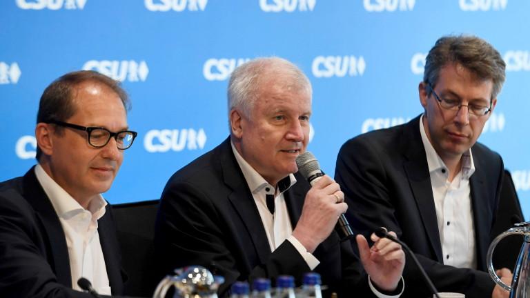 Консервативните партньори на Меркел недоволни от договореното за мигрантите