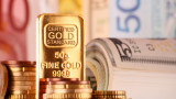 Цената на златото се понижава докато доларът укрепва